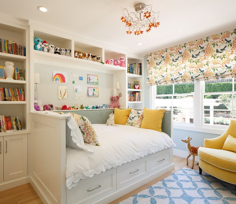 storage bed drawers pillows carpet windows bookshelves books chair pillows dolls chandelier transitional kids room