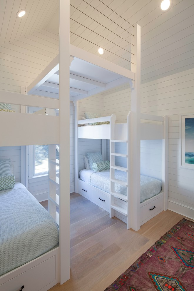 storage beds nyc light coloured floor carpet drawers window ladders ceiling lights beach style kids room new york