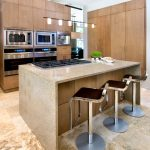 stove on brown granite top kitchen island