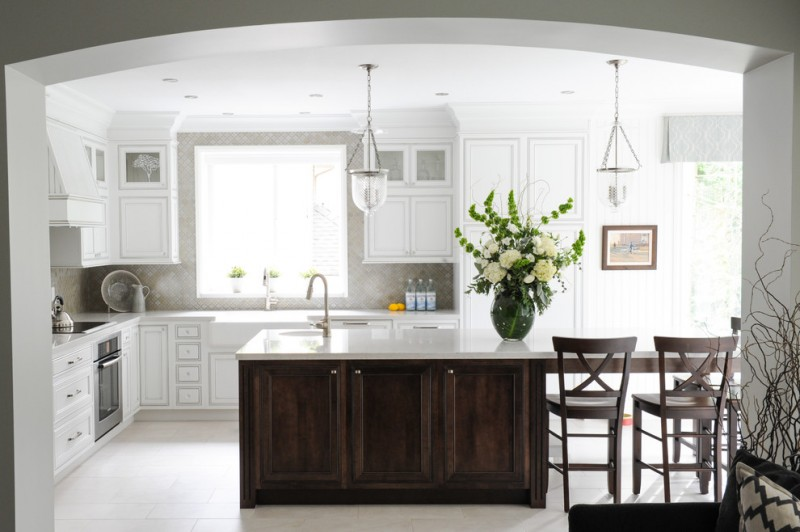 transitional and contemporary kitchen idea with dark wood kitchen island with white solid top undermount sink and faucet extended island's top to bar table cabinets and chairs