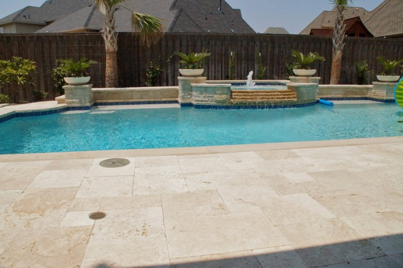travertine pavers pool deck fountains hot tub stone walls plant pots wood fence traditional design