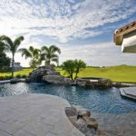 travertine pavers pool deck pillars jacuzzi fountains steel fence trees decorative plants mediterranean design