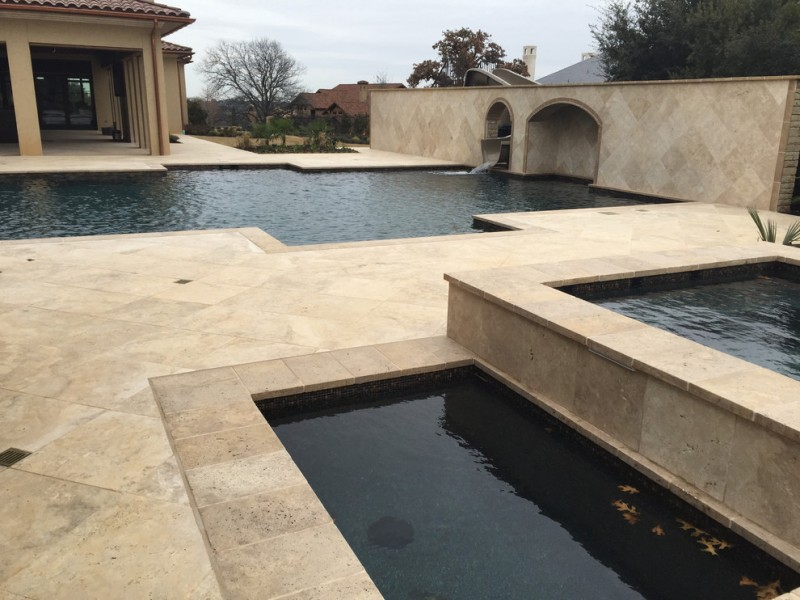 travertine pavers pool deck spa dome opening water slider windows decorative plants ceramic tiles traditional design