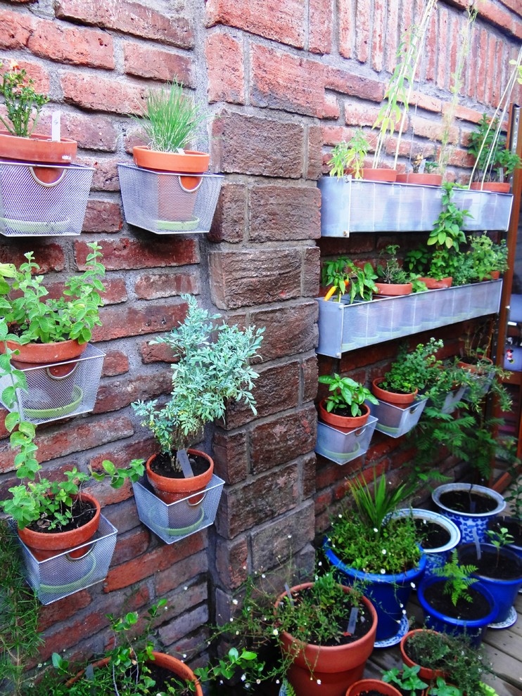 vertical garden plans brick walls plant pots decking traditional design
