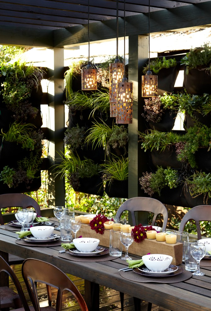 vertical garden plans narrow wood table dining chairs centerpiece column ceiling pendants decking industrial design