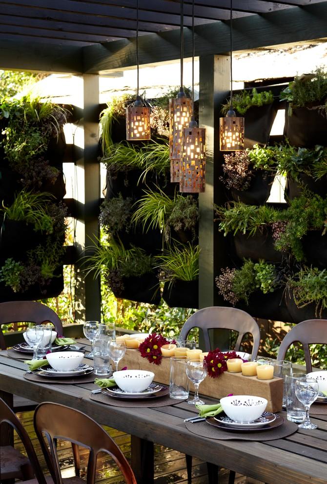 vertical garden plans narrow wood table dining chairs centerpiece column ceiling pendants decking industrial design