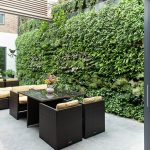 Vertical Garden Plans Rattan Chairs Benches Glasstop Table Concrete Slab Screen Panels Glass Door Climbing Vines Brick Walls Contemporary Design