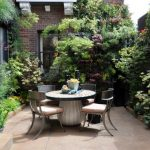 vertical garden plans round table chairs plant pots steps brick walls beige pavers contemporary design