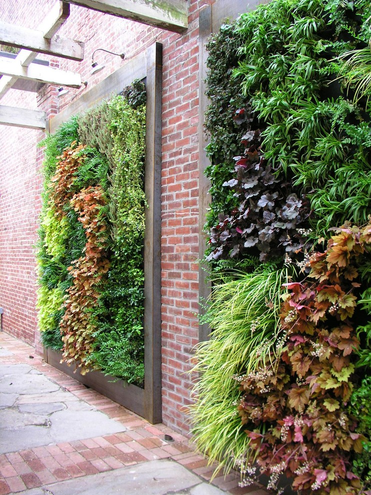 vertical garden plans stone pavers brick walls wood frame planters column covers contemporary design