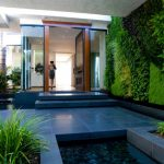 vertical garden plans stone slab floors pools planters glass door white wall ceiling lights wood frame steps contemporary design