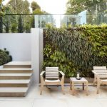 vertical garden plans wood armchairs table steps beige floors white walls planters contemporary design