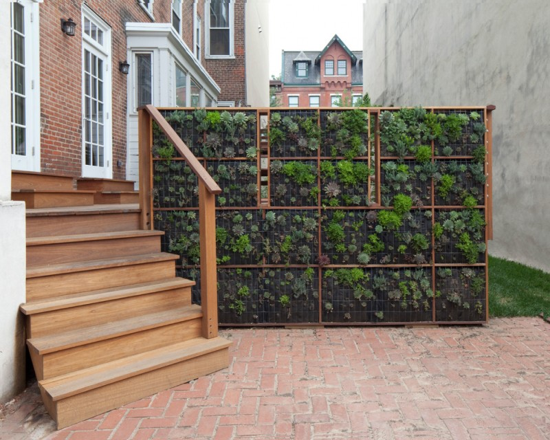 vertical garden plans wood stairs railing brick pavers walls white windows doors planters contemporary design