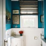 Vintage Style Bathroom With Pop Colors Choice Blue Walls Decorated By Wall Arts White Baseboard Unique Hang Lamp Small Glass Window With White Frame