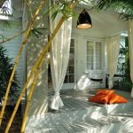 ways to hang curtains bamboo plants chair pillows window pendant light contemporary style porch