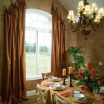 ways to hang curtains carpet table chairs window chandelier ceiling light plates decorative plant traditional dining room