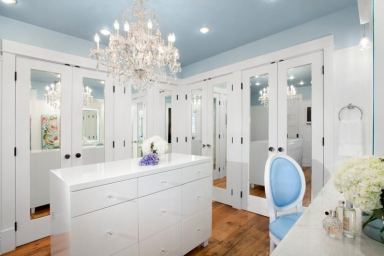 White Cabinets Medium Tone Hardwood Floors Beautiful Light Blue Ceiling  With Crystal Chandelier In Walk In
