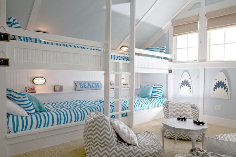 white painted bunk bed blue and white stripped fabrics nautical ornaments cream rug rattan shades white and grey stripped sofas and pillow throws round coffee table