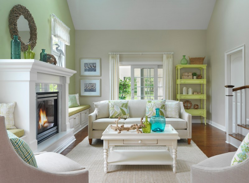 white rug green pillow throws white coffee table beige soffas beige green walls white ceiling, medium tone hardwood floors, standard fireplace stone fireplace surround