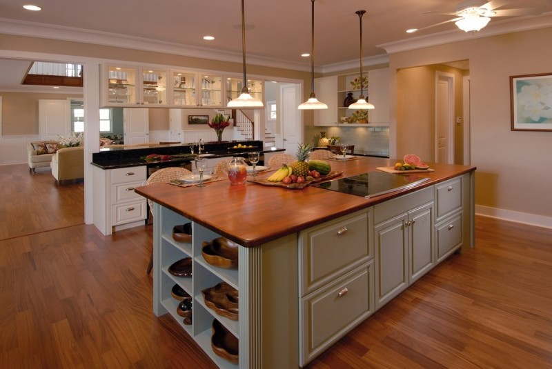 wood top kitchen island with storage and bar stools classic pendant lamps medium toned wood floors