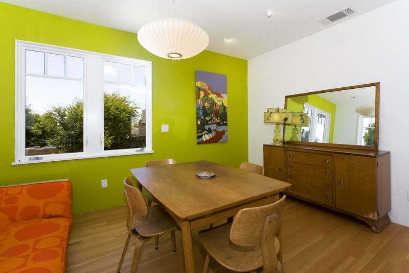 wooden table sets rectangular mirror hanging lamp green wall white wall table lamp wall art and medium tone hardwood floors