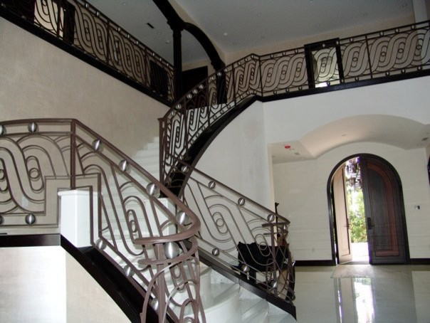 Wrought iron stair railings for stunning interior for Interior iron railing designs