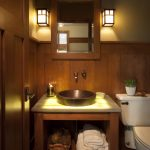 Mission Style Powder Room Idea Dark Hardwood Wainscoting Dark Yellow Walls Open Cabinet Under Sink Bathroom Vanity With White Top