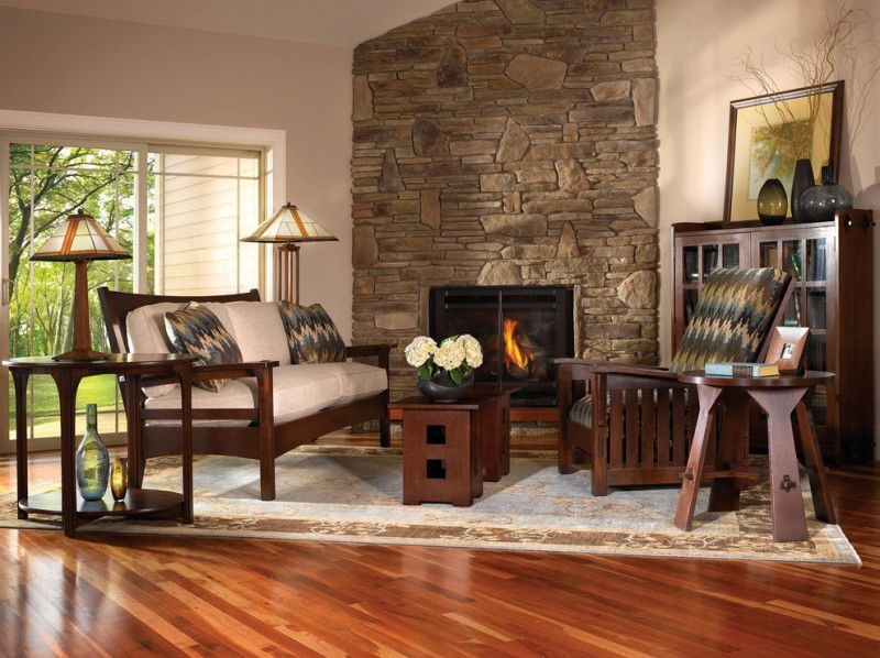 Mission style living room idea natural rock fireplace handcrafted chairs and center table in dark color dark toned wood floors concrete walls