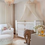 baby girl bedroom themes couch upholstered ottoman crib stuffed elephant white cabinet pendant wallpaper carpet curtain transitional design
