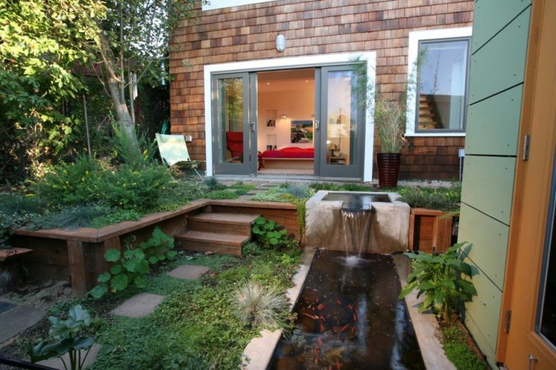 back yard pond doors tree plants fish chair stairs window contemporary landscape