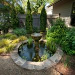 back yard pond plants fountain fence house exterior flowers traditional landscape
