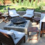 Backyard Patio With A Fire Feature And Decomposite Granite Sand Floor Deck Wooden Floor IKEA Chair Sets White Pillow Throws