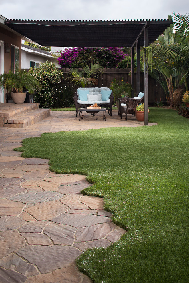 backyard paver ideas curved grass patio roof black rattan armchairs iron and glass table artistic and absract pavers