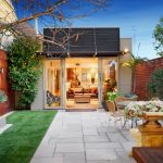 backyard paver ideas grass polished concrete paver aluminum brown chairs and table sliding glass doors minimalist home