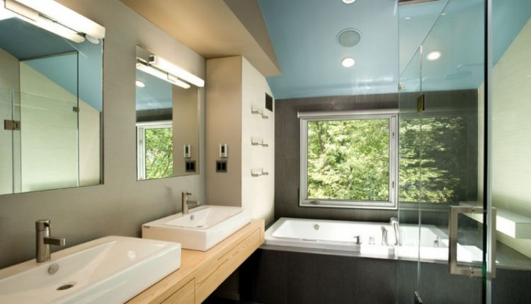 bathroom color combinations blue ceiling black wall tub frame floor dark cream cabinet double sink large mirror with lamp rectangle tub shower glass door
