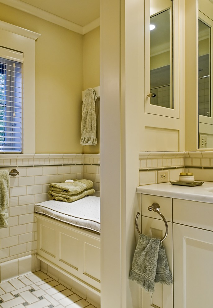 bathroom with tiles floor, white wooden cabinet, with round towel bar,