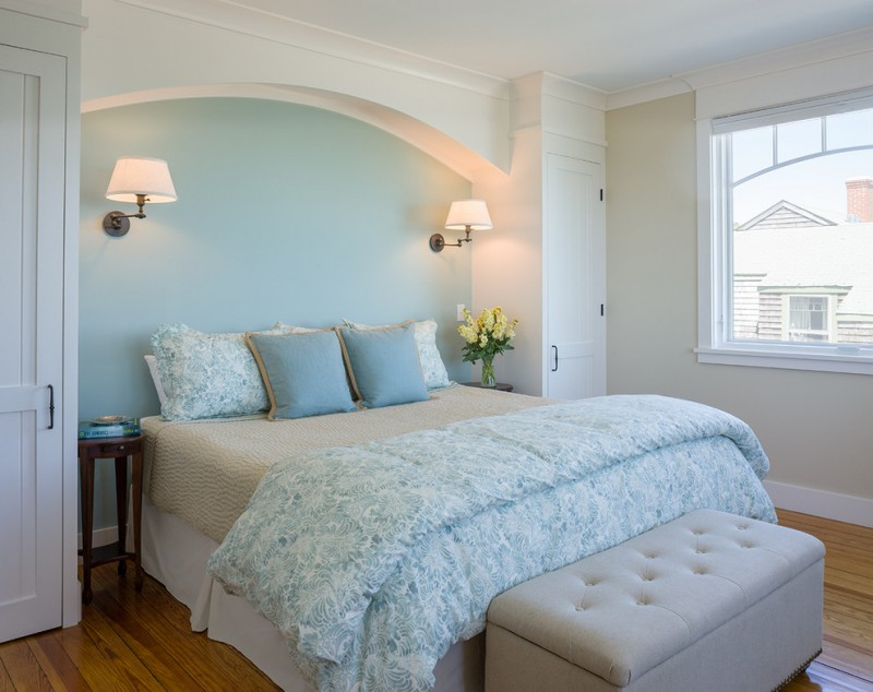 beach style bedroom light blue comforter light blue shams light beige bed skirt white walls medium toned wood floors