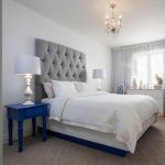 Beach Style Bedroom White & Textured Duvet Contemporary Bed Frame With Higher Headboard Navy Blue Bedside Table White Table Lamp White Console Table Grey & Textured Area Rug Medium Toned Wood Floors