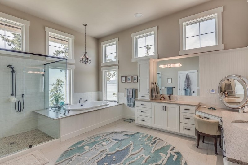 beach themed bathroom decor ocean or seaglass rug in round powder room large shower area with glass door bathtub