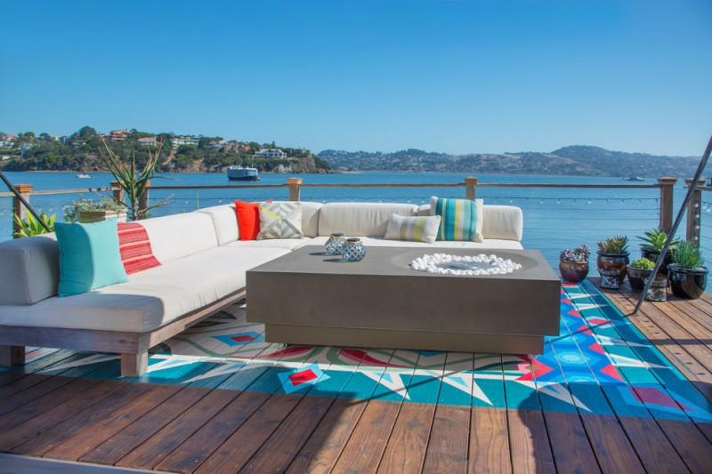 best deck paint wood floor railing table decorative plants sofa pillows eclectic area