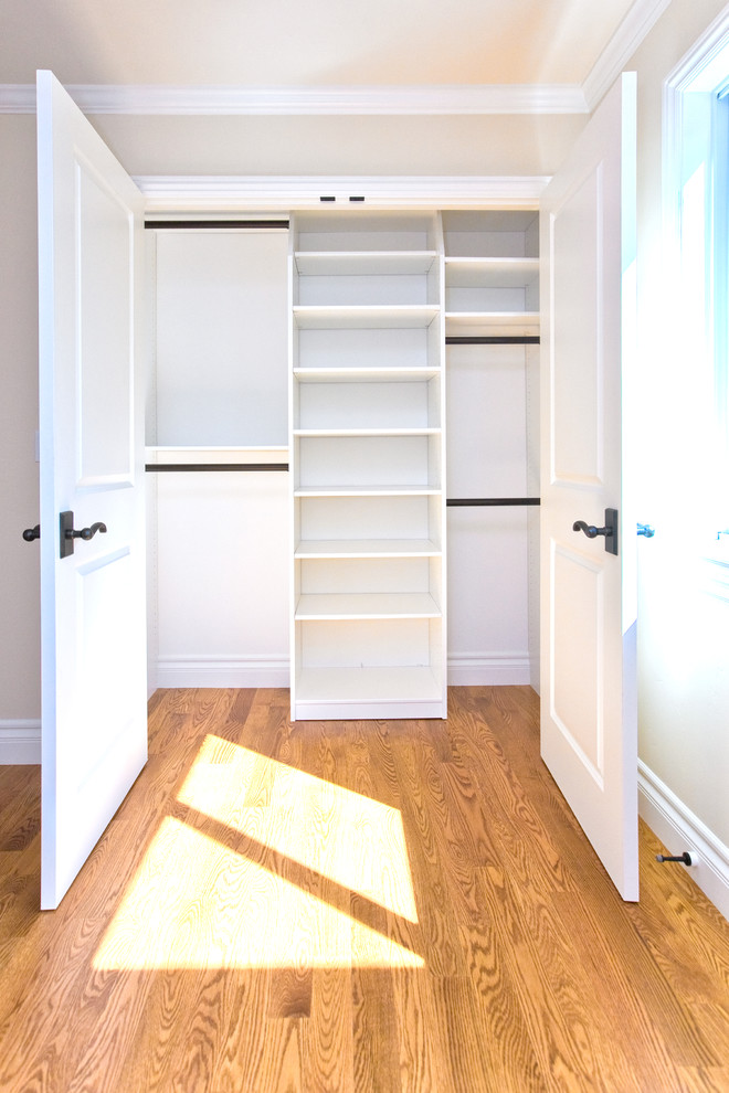 Big Walk In Closet Wood Floor Shelves Doors Window Traditional Bedroom