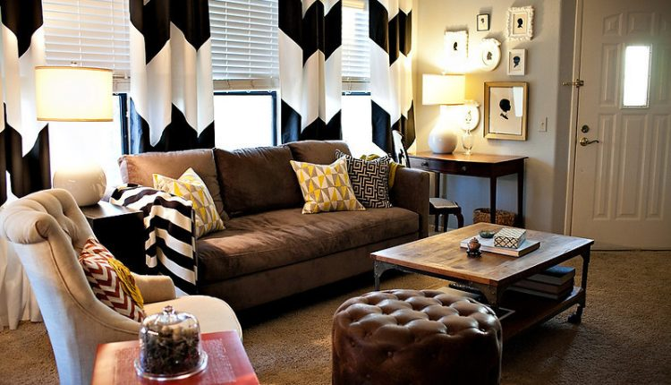 black and white room decorations traditional sofa cute as a button erin chair industrial wood and metal aiden coffee table hand fired ceramic table lamp soft brown rug brown puffy ottoman