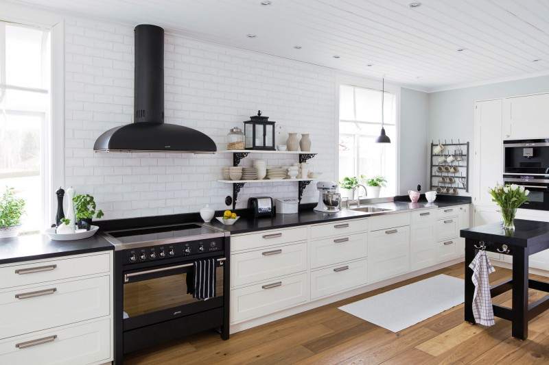 white kitchen cabinets black appliances tile countertops whi
