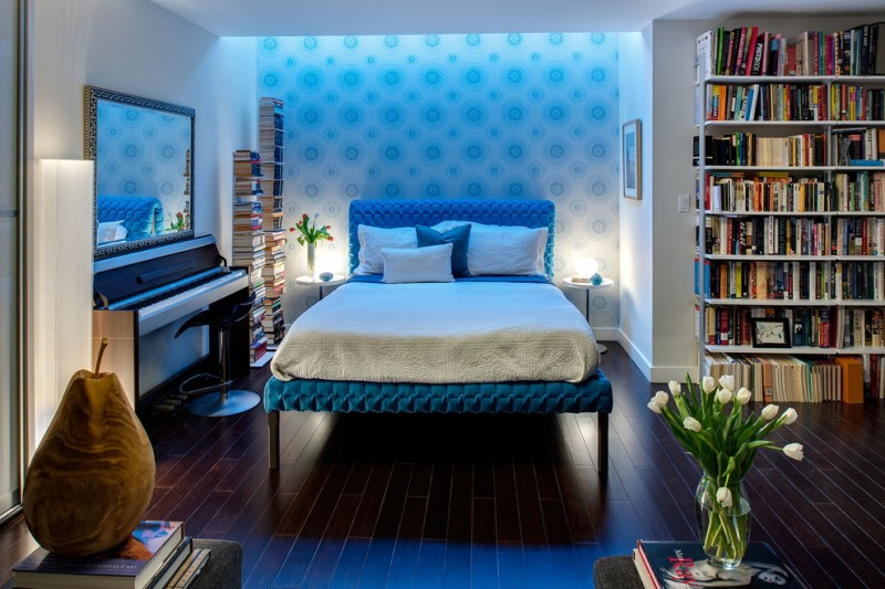 blue bed frame with headboard white bedding idea dark toned woodboard floors blue polka dots wallpaper white walls white book rack