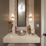 bowl sink floating vanity accent wall high mirror grey wall tiled floor pendant lights wall sconce