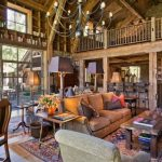 Cabin Designs And Floor Plans Carpet Hardwood Floor Chandelier Table Chairs Ladder Bookshelves Rustic Family Room