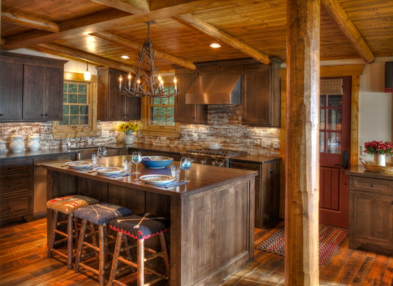 cabin designs and floor plans pillar stools island wood floor flowers wall cabinets chandelier windows stove countertop rustic kitchen