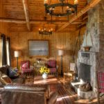 cabin designs and floor plans wood floor chairs tables chandelier flowers wall decor curtains rustic living room