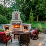 classic patio design with brick pavers and a fire feature wood storage red and brown soffas round coffee table brick floors