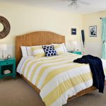 Coastal Bed Treatment With Gold Striped Comforter Woven Bed Frame With Headboard Turquoiso Bedside Tables Light Cream Walls White Ceilings Turquoiso Window Curtains