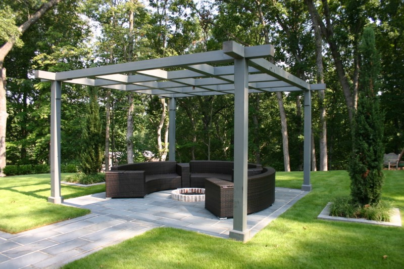 contemporary patio idea with solid and dark grey pergola concrete pavers walkway rounded couch in black center firepit